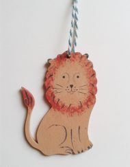 'Lion' wooden decoration (facing left), designed and hand-painted by Elizabeth Harbour