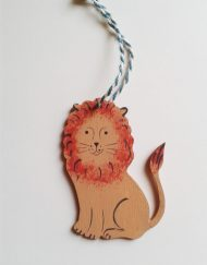 'Lion' wooden decoration (facing right), designed and hand-painted by Elizabeth Harbour