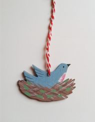 'Little Bird in Nest' wooden decoration, designed and hand-painted by Elizabeth Harbour