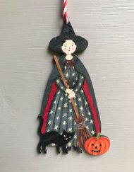 Witch wooden decoration by Elizabeth Harbour
